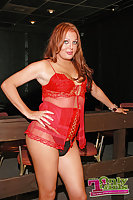 Redhead in red lingerie toying
