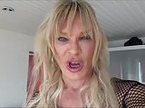 Mature blonde tranny solo on a sofa