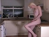 Slender blonde girl solo with a toy