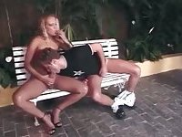 Blonde tranny and dude playing on amusement park