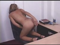 TS lady masturbating with dildo at the office