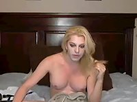 Solo blonde TS plays with white dildo