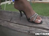 Tranny babe Bruna Rodrigues tugging her cock outdoors