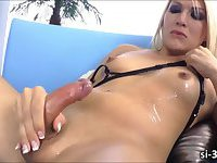 Pretty tranny Gianna Rivera drills pussy with her healthy shecock