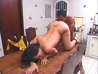 Chap penetrates a Latina tranny on a table