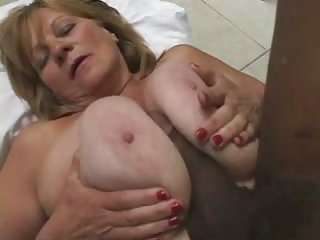 Mature white girl & big dick ebony tranny titfuck