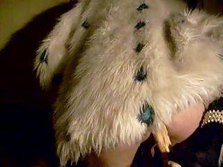 Dildoing in fur coat