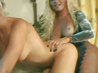 Blonde whore in threeway action