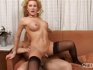 Blondie in stockings riding dick on sofa