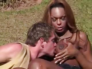 Randy guy drills chocolate TS babe in doggy style