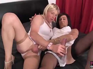 Crossdresser slut in sexy lingerie spit roasted and takes spunk in her face