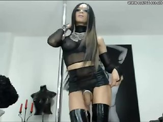 Webcam solo of a tranny with a big tool